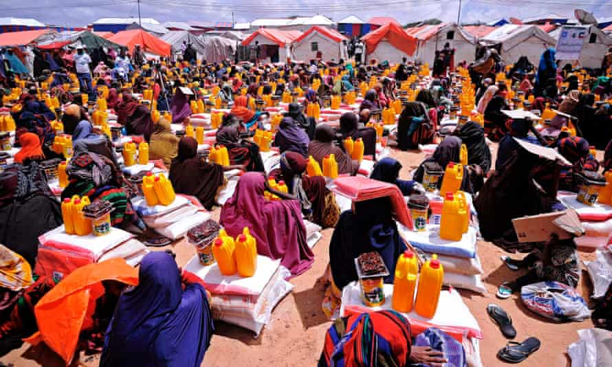 People receiving food aid at a distribution centre outside Mogadishu.