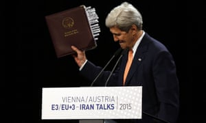 John Kerry, US secretary of state, holds up the Iran nuclear agreement at a press conference in Vienna.