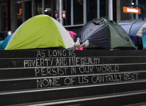 A slogan is written on steps next to the area where tents used by homeless people sit in Martin Place in the Central Business District. Dozens of tents have been erected since December despite attempts by authorities to move people on, Sydney, Australia