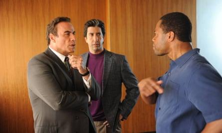 From left, John Travolta as Robert Shapiro, David Schwimmer as Robert Kardashian, and Cuba Gooding Jr as O J Simpson.