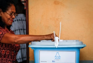A woman casts her vote during the presidential election at a polling station in Dili, Timor-Leste, on Monday.