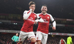 Mesut Özil and Sead Kolasinac celebrate Özil's goal, the third Arsenal scored in the space of four second-half minutes at the Emirates Stadium.