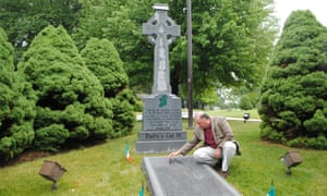 Bill Watson looks at the memorial for 57 railroad workers who died while building Duffy's Cut, the 59th mile of the Pennsylvania Railroad, in 1832.
