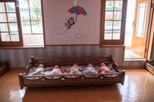 Employees' babies sleep in the nursery at the Kim Jong Suk Silk Factory.