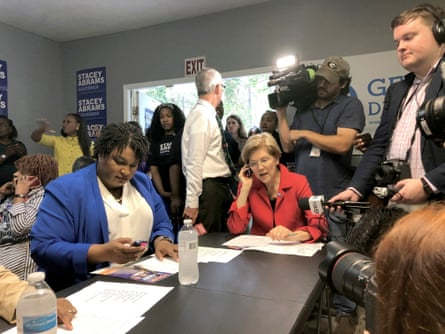 Stacey Abrams, left, and U.S. Sen. Elizabeth Warren, a Democrat, right, called voters to rally support for Abrams at an event in Jonesboro, Georgia.