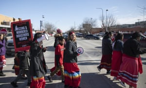 People march in downtown Rapid City, South Dakota, 14 February 2019, to call attention to missing and murdered Native American women and girls.