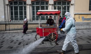 An employee from Istanbul Municipality disinfects Istanbul's famous Istiklal street to prevent the spread of the COVID-19, coronavirus on March 18, 2020 in Istanbul, Turkey.