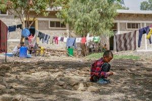 A child plays in a camp for internally displaced people in Mekelle, Ethiopia