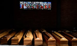 Coffins of people who have died from coronavirus disease (COVID-19) are seen on 23 March in the church of the Serravalle Scrivia cemetery, which like many places in northern Italy is struggling to cope with the number of deaths.