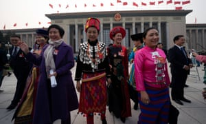 Delegates from ethnic minorities leave the Great Hall of the People in Beijing, China, on Sunday.
