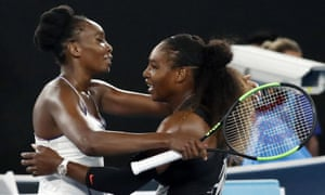 Venus and Serena embrace after their final in Melbourne.