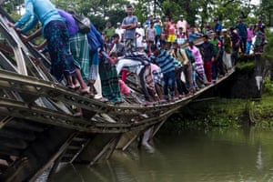 Sylhet, BangladeshBangladeshi pedestrians cross a broken bailey bridge. While heavy vehicle movements have usually been restricted on this bridge, it collapsed when a truck loaded with cement bags tried to cross it