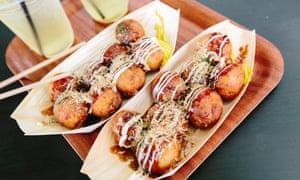 Having a ball … takoyaki octopus dumplings on Dotonbori.