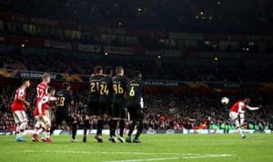 Arsenal's Nicolas Pepe curls in the free-kick to score Arsenal's third.
