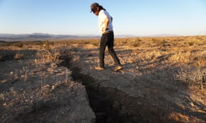 A local resident inspects a fissure in the earth after an earthquake struck the area near Ridgecrest, California, on 4 July.