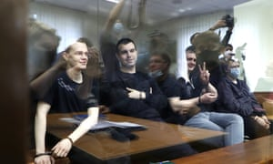 Ruslan Kostylenkov (centre) attends a hearing at Moscow's Lyublinsky district court with other defendants.