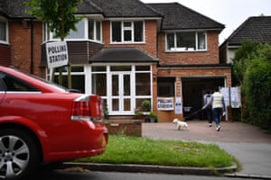 Voters arrive at a polling station set up in the garage of a house in Croydon, south London.