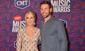 Underwood and husband Mike Fisher at the CMT music awards in Nashville, earlier this month.