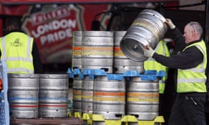 A Fullers brewery employee lifting a barrel. Japanese brewer Asahi bought Fuller Smith & Turner's for £250m this year.