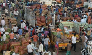 Farmers and traders negotiate prices at a wholesale vegetable market in Hyderabad on 9 October 2020.