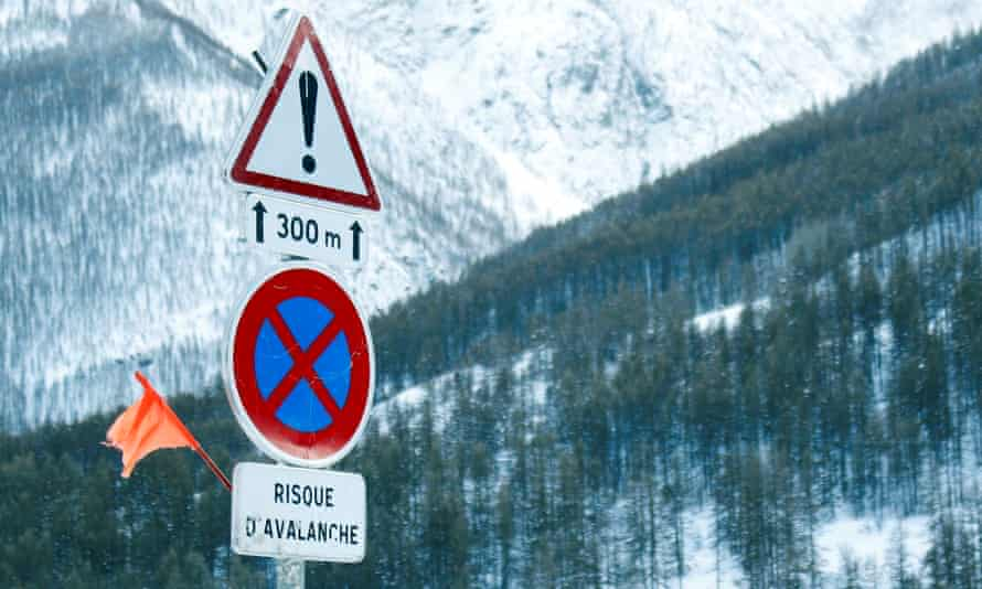 Sign reading 'avalanche risk' pictured on a snow-covered road in southern France