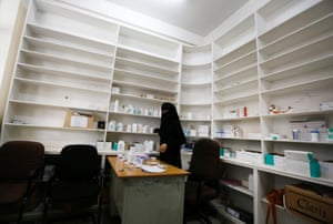 A worker is pictured in a government hospital's drug store in Sana'a, Yemen