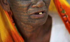 Sumitra Devi, 70, a follower of Ramnami Samaj, who has tattooed the name of the Hindu god Ram on her entire face