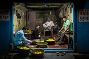 Marigold stringers in Veraval, Gujarat. Although fluorescent, the lighting lent this scene a painting-like quality.