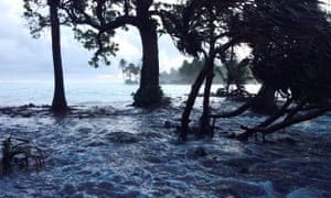 Storm surges washing across Ejit Island in Majuro Atoll, Marshall Islands, in early 2014.