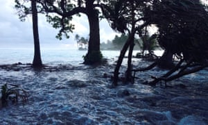 A high tide boosted by storm surges wash across Ejit Island in Majuro atoll, in the Marshall Islands. Research suggests that by 2050 up to 1.7 million people will be displaced by climate change across the Pacific.
