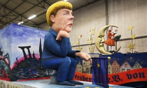 A float featuring a depiction of the German chancellor Angela Merkel is ready for a carnival in Cologne.