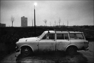 Dog waiting in car, North Circular Road, Wembley, 1979