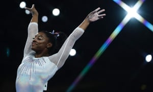 Simone Biles reacts after performing on the vault.