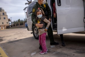 A US Border Patrol agent leaves a young asylum seeker and her family at a bus station in Brownsville, Texas, last month. US immigration authorities are releasing many families detained while crossing the US-Mexico border. The families are free to travel to destinations throughout the US while awaiting asylum hearings.
