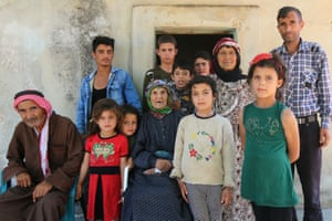 Idlib, Syria. Noura Heimish poses with her family including her great-grandchildren, at her home in the Umm el-Rish village in the countryside of a rebel-held province