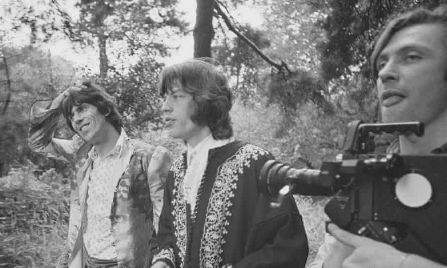 Peter Whitehead, right, with Mick Jagger, centre, and Keith Richards during the filming of We Love You in 1967.