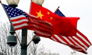 A lamp post outside the White House is adorned with Chinese and US national flags in Washington.