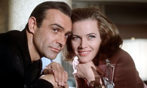 James Bond (Sean Connery) attends to the 'psycho-pathological malady' of Pussy Galore (Honor Blackman).