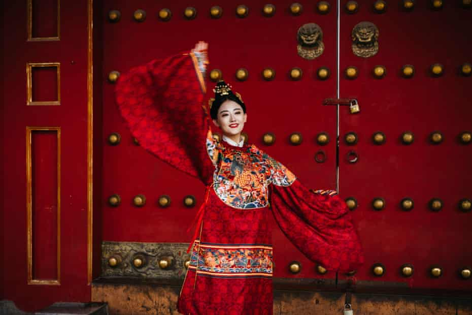 A women performs at the Forbidden City.