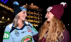 Emma Spencer and Mikayla Slater pose for a photograph as they arrive for Game 3