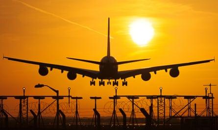 A380 Airbus landing at sunset