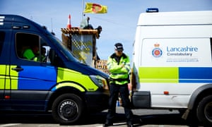 Lancashire police guard protesters at the site in Fylde where Cuadrilla has permission to frack
