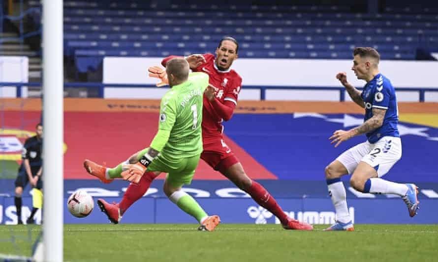 Virgil van Dijk is tackled and injured by Jordan Pickford in the Merseyside derby on Saturday.