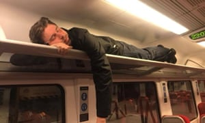 A man sleeps after being trapped on train