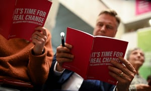 Attendees read copies of the Labour Party election manifesto