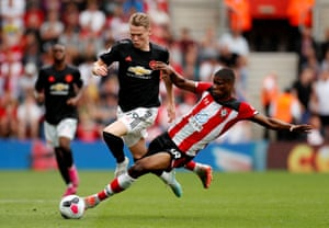 Southampton's Kevin Danso brings down Manchester United's Scott McTominay and is subsequently sent off by referee Mike Dean.