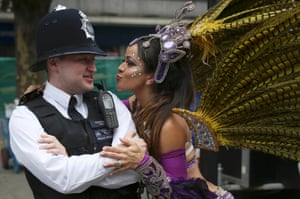 A performer dances with police