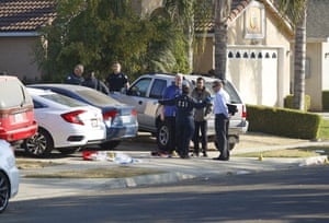 Fresno police investigators work on the scene where four people were killed and six wounded on Sunday night.