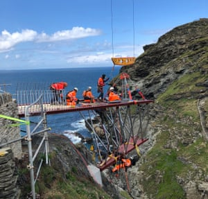 Riggers install the castle's new footbridge.