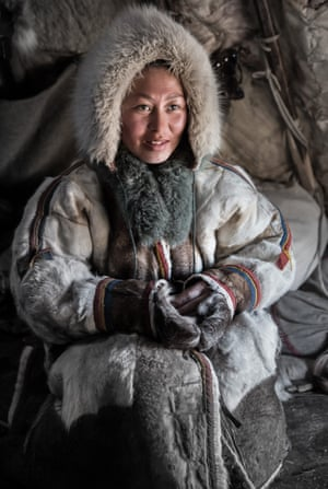 A Nenet woman poses for a photograph at Nomad camp